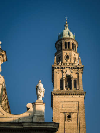 Detail of a church bell tower in the Italian city of Parma. during the sunset
