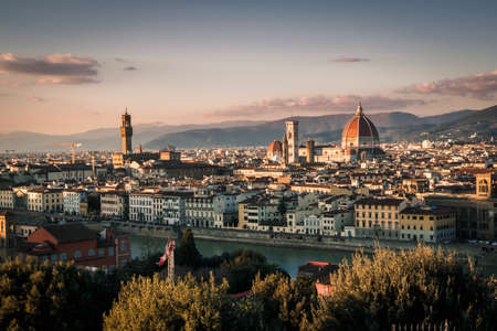 View of Florence from Piazzale de Michelangelo during sunset with the Palazzo Vecchio and the Florence Cathedral