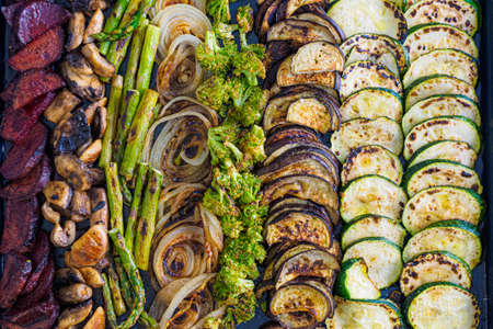 Different types of roasted vegetables in the oven