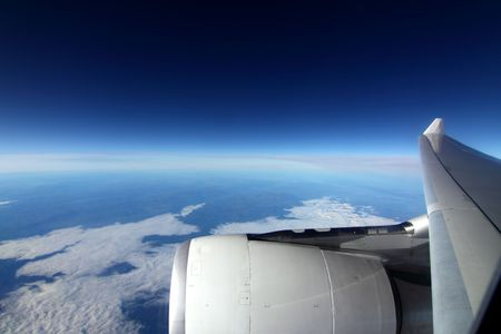 Wing of the plane on a background of sky 스톡 콘텐츠