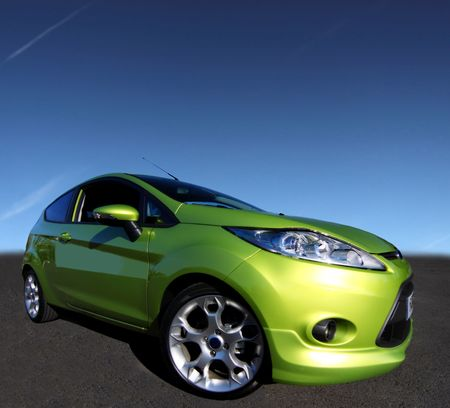 a fantastic green car on a great blue sky Stock Photo