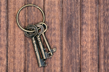 three old keys on a wooden background Stock Photo - 20286627