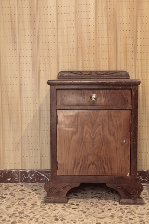 a very old nightstand with a vintage floor and wall Stock Photo - 21821688