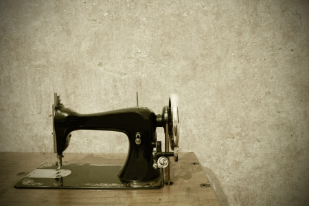 a very old sewing machine on a white background Standard-Bild