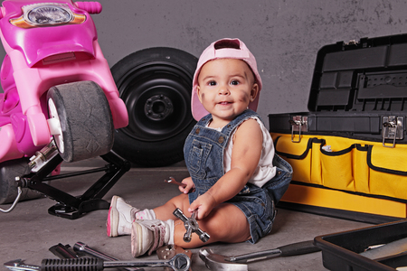 baby mechanic working in her toys photo