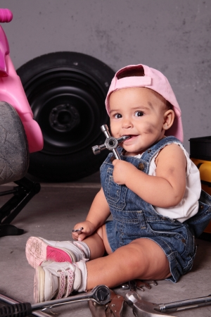 young beautiful girl working like mechanic