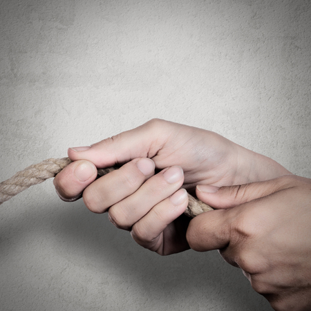 a human hand taking a rope, concept of strong