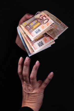 dirty hands: dirty hands grabbing Euro banknotes Stock Photo