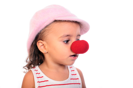 beautiful girl with a clown red nose photo