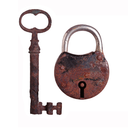 old and rustic padlock and key Isolated on white photo