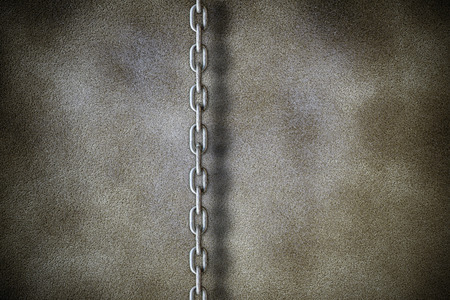chains on a stone wall photo