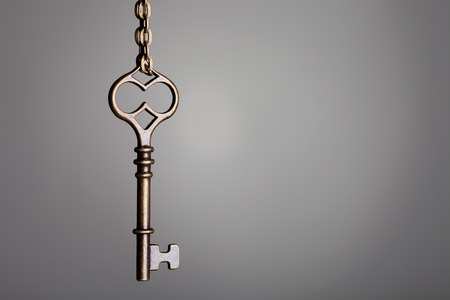 picture of an old keys on a grey background photo