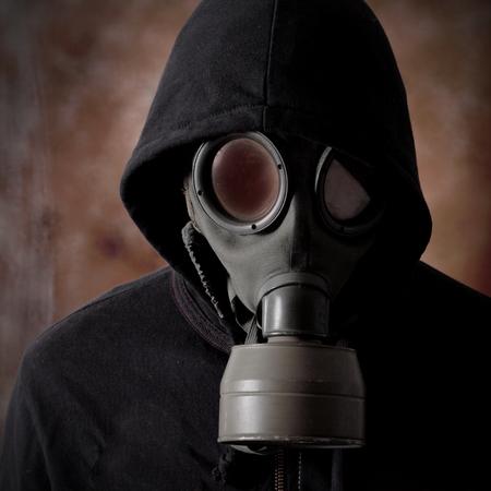 gasmasker: man met een gasmasker Stockfoto
