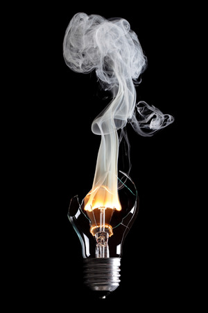 bulb exploding with fire and smoke
