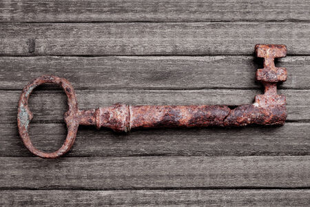 18th century antique key on a wood table photo