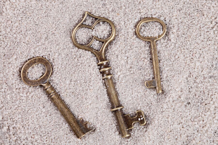 old vintage keys on the sand photo