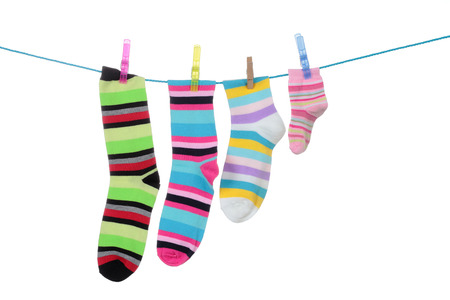 colorful striped socks hanging on a white background Stock Photo
