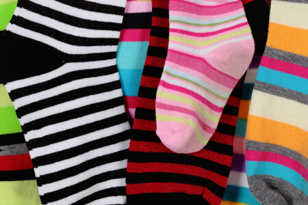 detail of a striped wool socks of a family photo