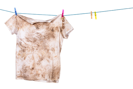 dirty shirt hanging to dry Stock Photo