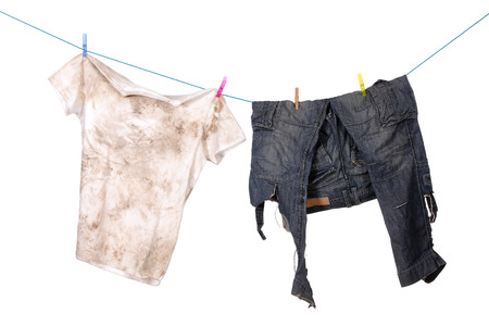 dirty shirt and trousers hanging to dry