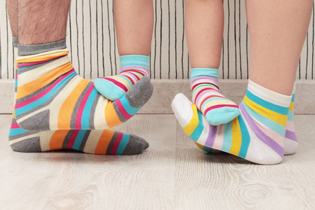 feet of a beautiful family with striped socks Stockfoto