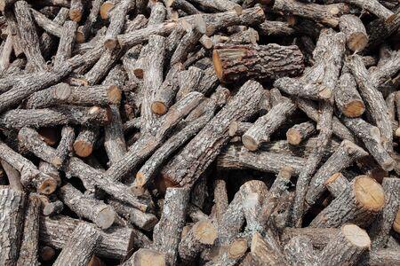 disorganized: large pile of stacked firewood and disorganized