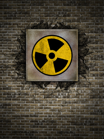 polution: symbol of nuclear danger on an old wall