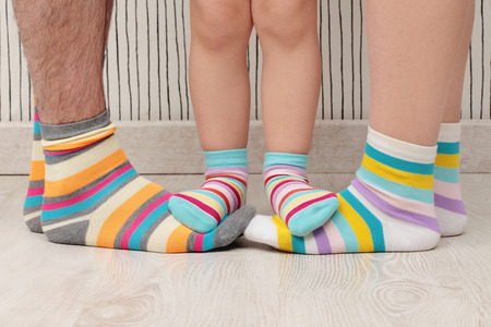 dad, mom and daughters with socks