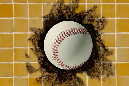 embedded: baseball ball embedded in a tiles wall Stock Photo