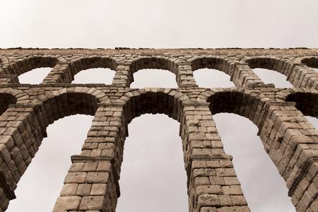 aqueduct: an old stone aqueduct in Segovia, Spain