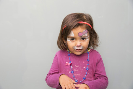 2 years: 2 years girl with the face painted like a cat