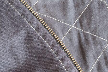 unzipped: Zipper and fabric cloth Stock Photo