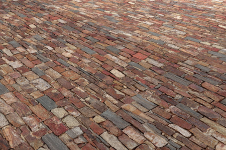from below: 3d rendering of old wallpavement made of different bricks. From below