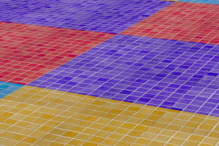 glazed: 3d rendering of a close-up of colorful ceramic wall made of glazed tile: yellow, blue, navy blue and red.