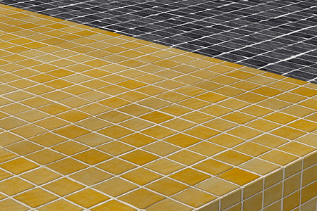 glazed: 3d rendering of a close-up of yellow and black checked glazed tile
