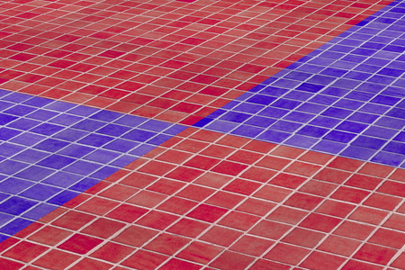 glazed: 3d rendering of a close-up of ceramic floor made of red and blue glazed tile.From above. Stock Photo