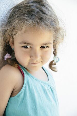 tank top: Close-up of cute little girl with two braids in blue tank top Stock Photo