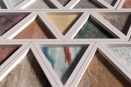 3d Renderingl Wall With Triangles Of Different Materials In White