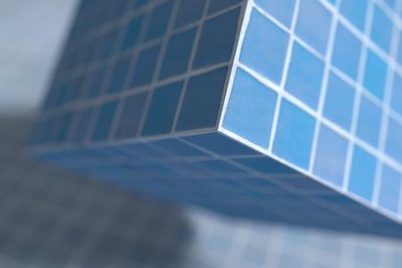 tiled floor: 3d rendering of close-up of blue glazed cube under tiled floor Stock Photo