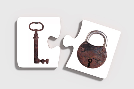 old padlock: 3d rendering of Two three-dimensional pieces of puzzle with rusty padlock and key on grey background. From above. Isolated.