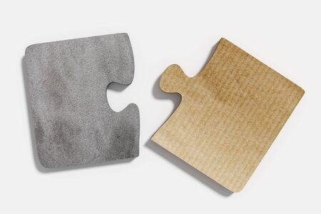 paperboard: 3d rendering of two puzzle pieces made of paperboard and stone material on white background Stock Photo