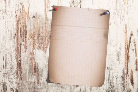 pinned: 3d rendering of a lined page pinned on shabby wooden planks
