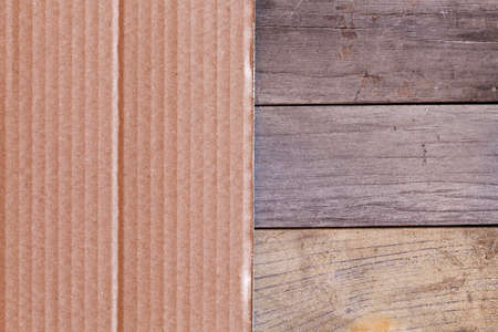 paperboard: Paperboard on wooden planks in close-up.