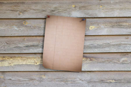 ruled paper: 3d rendering of a lined page pinned on shabby wooden planks