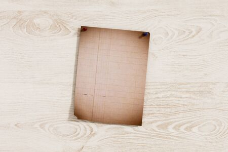pinned: 3d rendering of a lined page pinned on shabby wooden plank