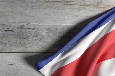 bandera de costa rica: representación 3D de la bandera de República de Costa Rica en una superficie de madera Foto de archivo