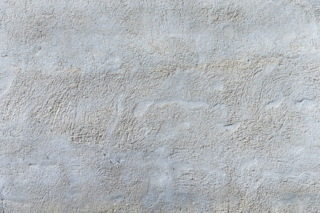traces: Grey concrete wall with traces in close-up. Stock Photo