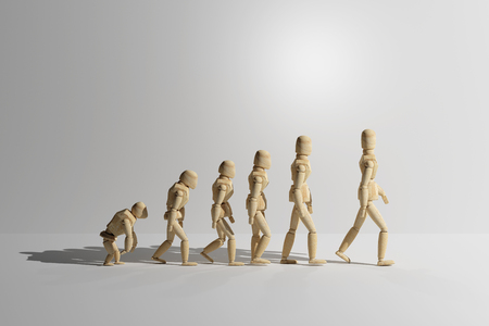 human evolution: 3d rendering of wooden mannequin toys prototype of human evolution. Copyspace. Stock Photo