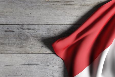 木製の背景に手を振るインドネシア共和国旗の 3 d レンダリング