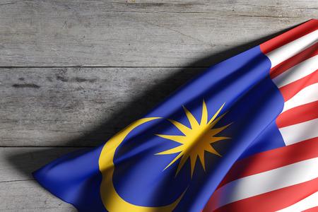 Representación 3D de la bandera de Malasia ondeando en el fondo de madera Foto de archivo